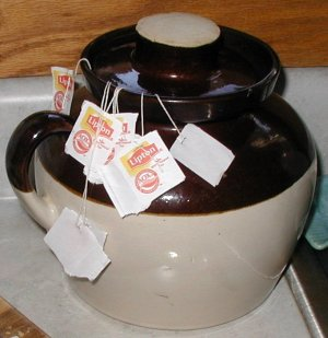 Bean pot with lid for saving kitchen scraps.