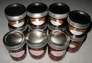 Eleven wineberry jam jars labeled for the pantry.