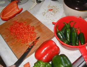 Preparing peppers for making jam.